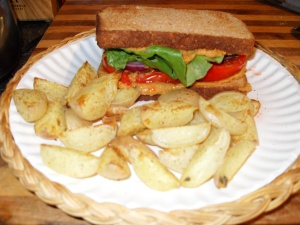 Cheezy Hummus sandwich with baked potato fries