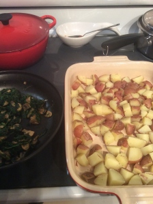 Cooked spinach/mushroom and potatoes awaiting sauce and assembly.